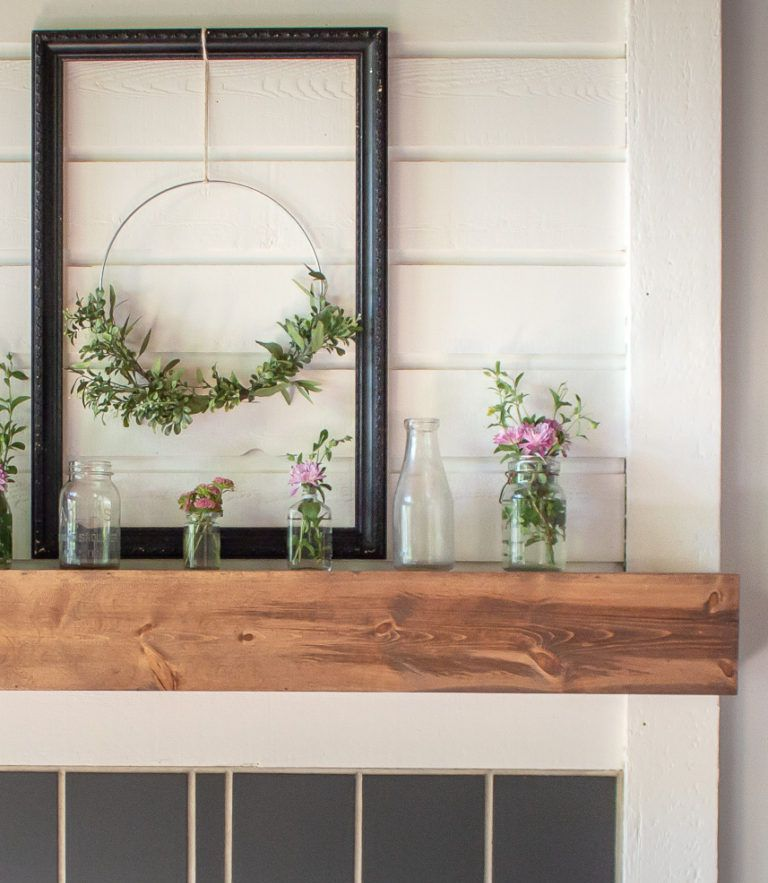 Wooden fireplace mantel with flowers