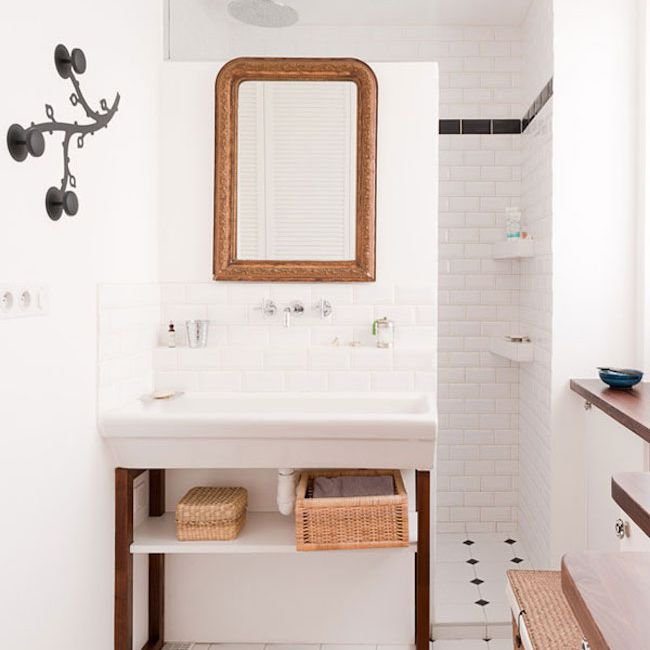 Brown-and white-bathroom with sink and mirror.