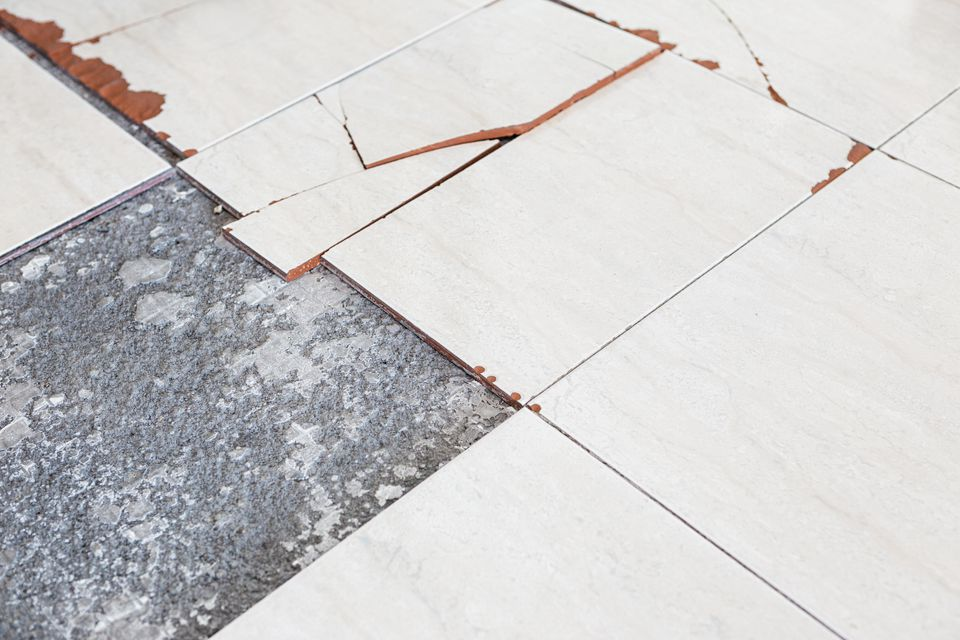 Damaged floor tiles