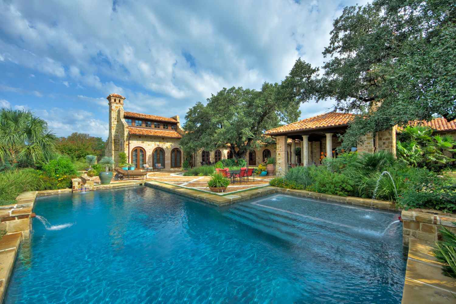 Tuscan pool with fountains
