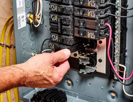 Circuit breaker in service panel being replaced