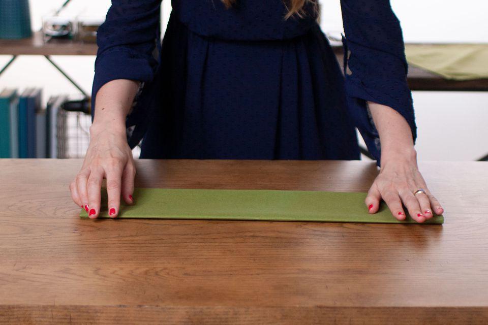 A woman folding a napkin