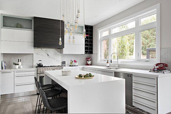 white quartz waterfall countertop modern kitchen