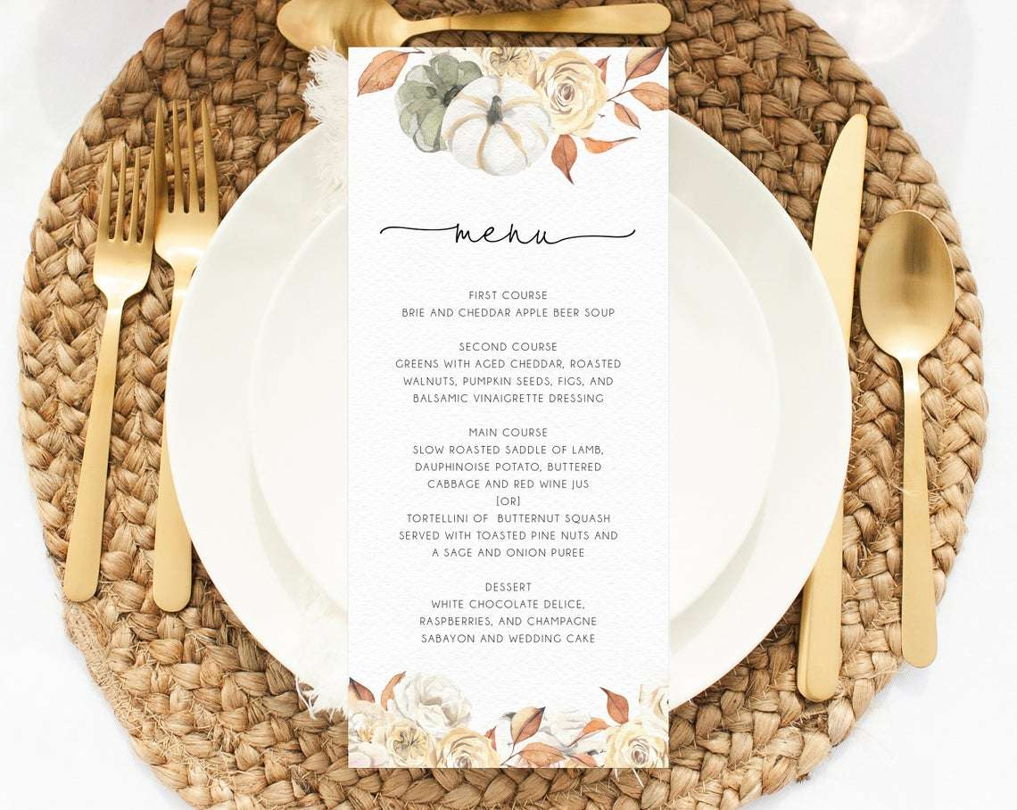 A place setting with a menu on top of a plate