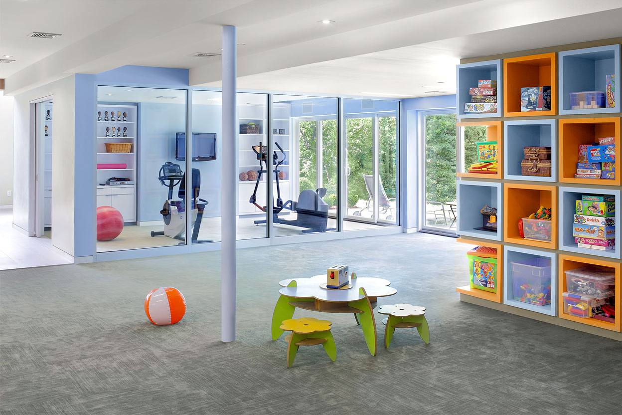 A basement home gym with child's playroom