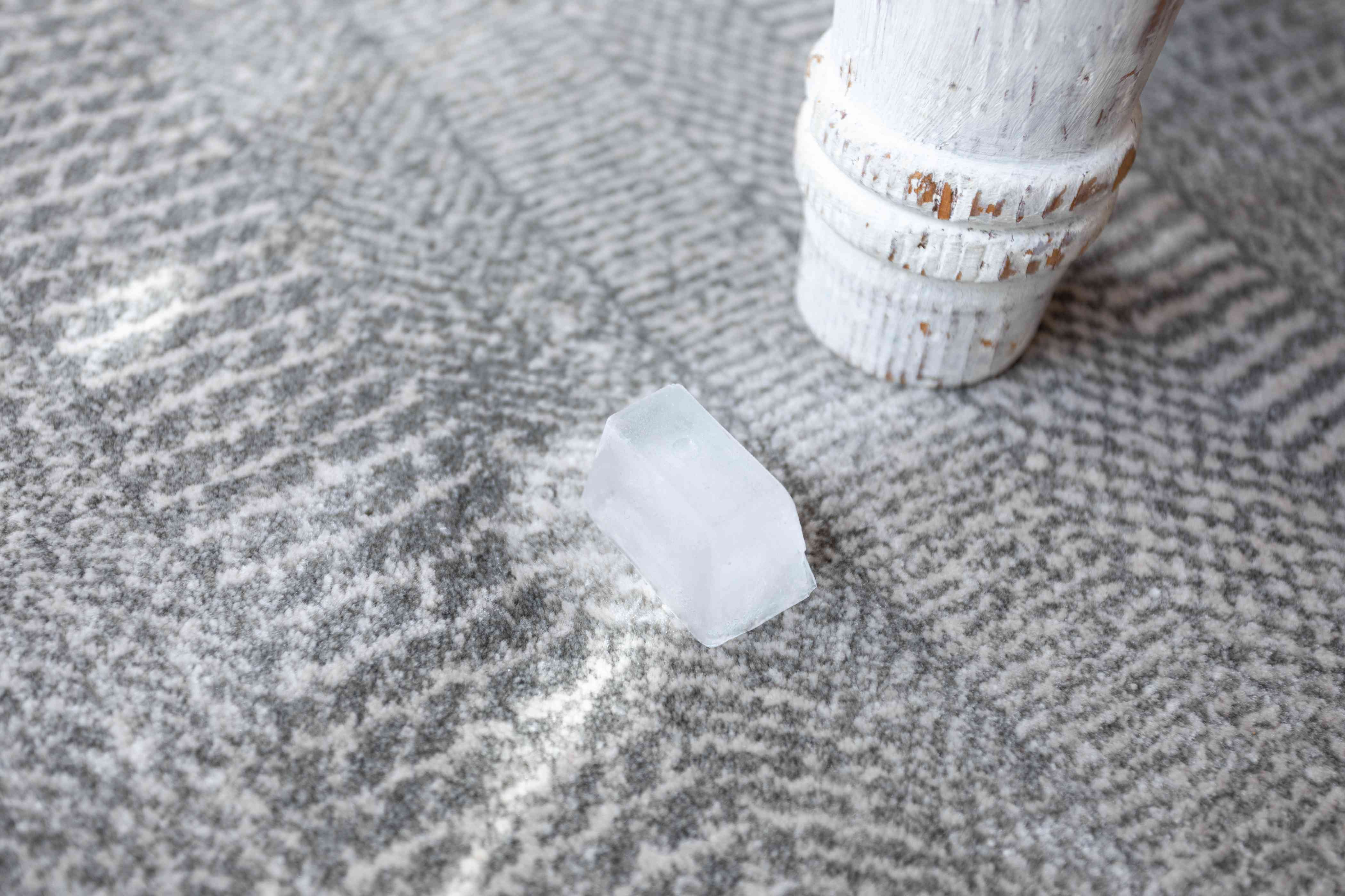 ice cube on a rug to fix dents