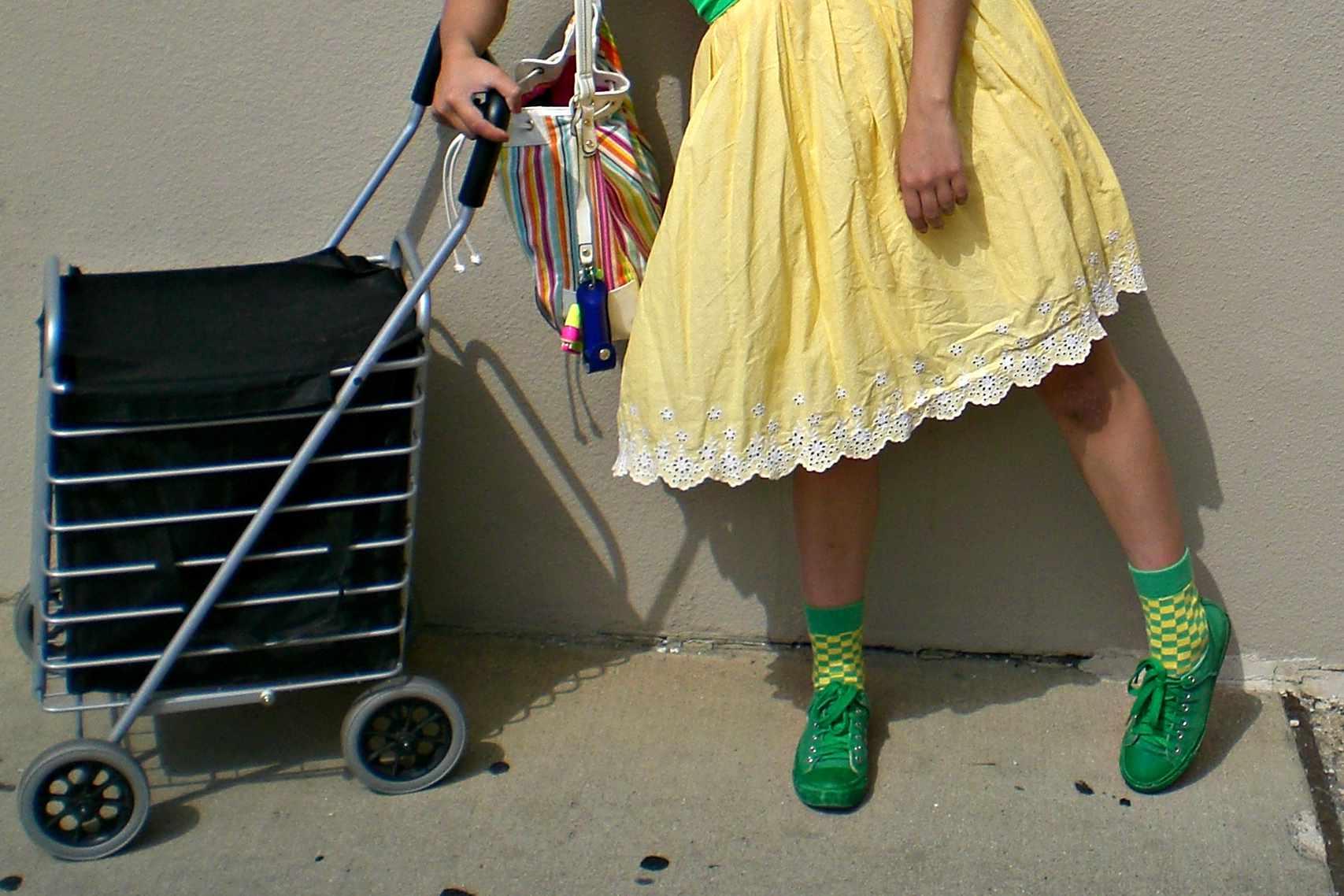 flea market shopper with a folding cart
