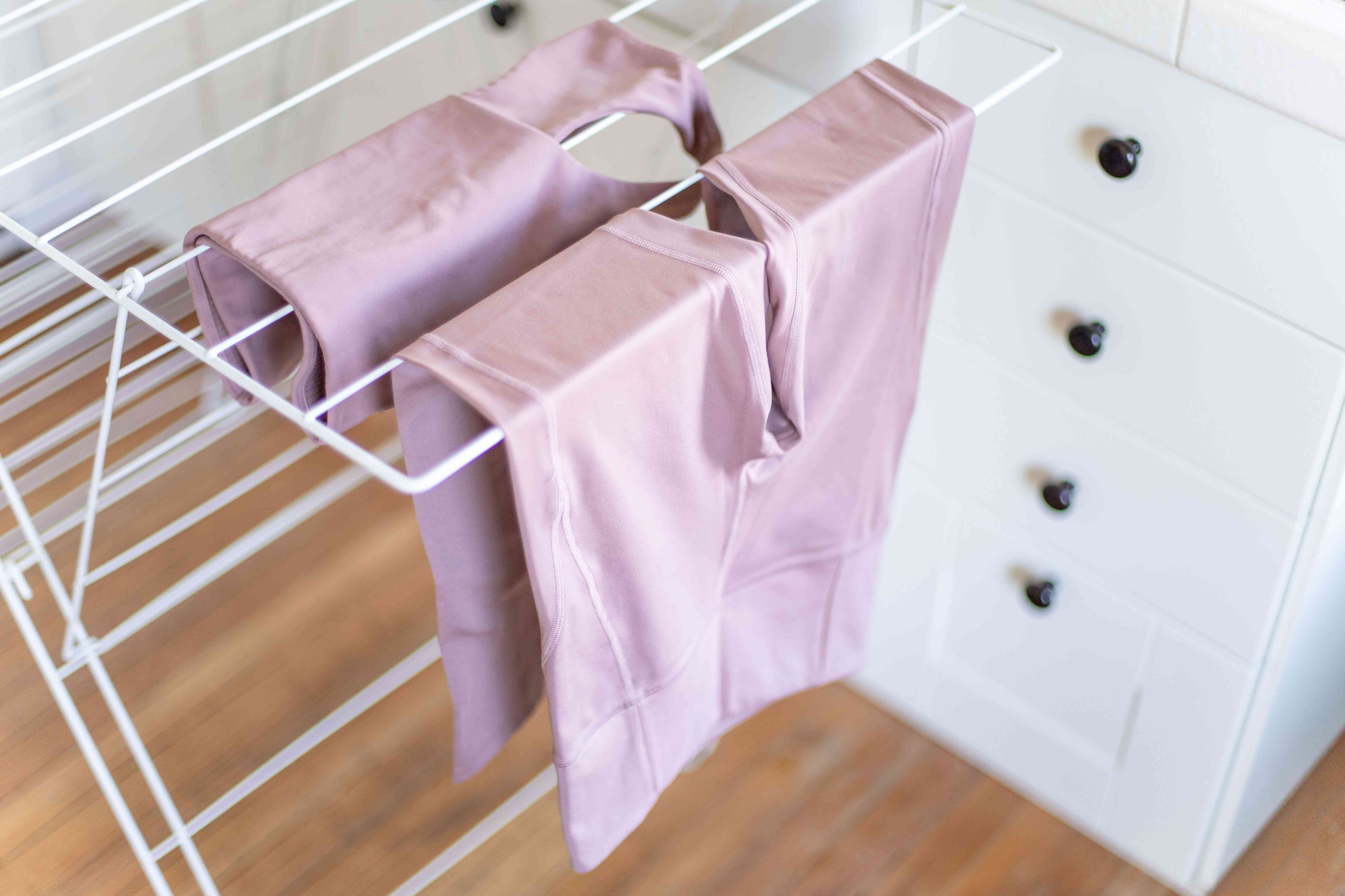 Workout clothes on a drying rack