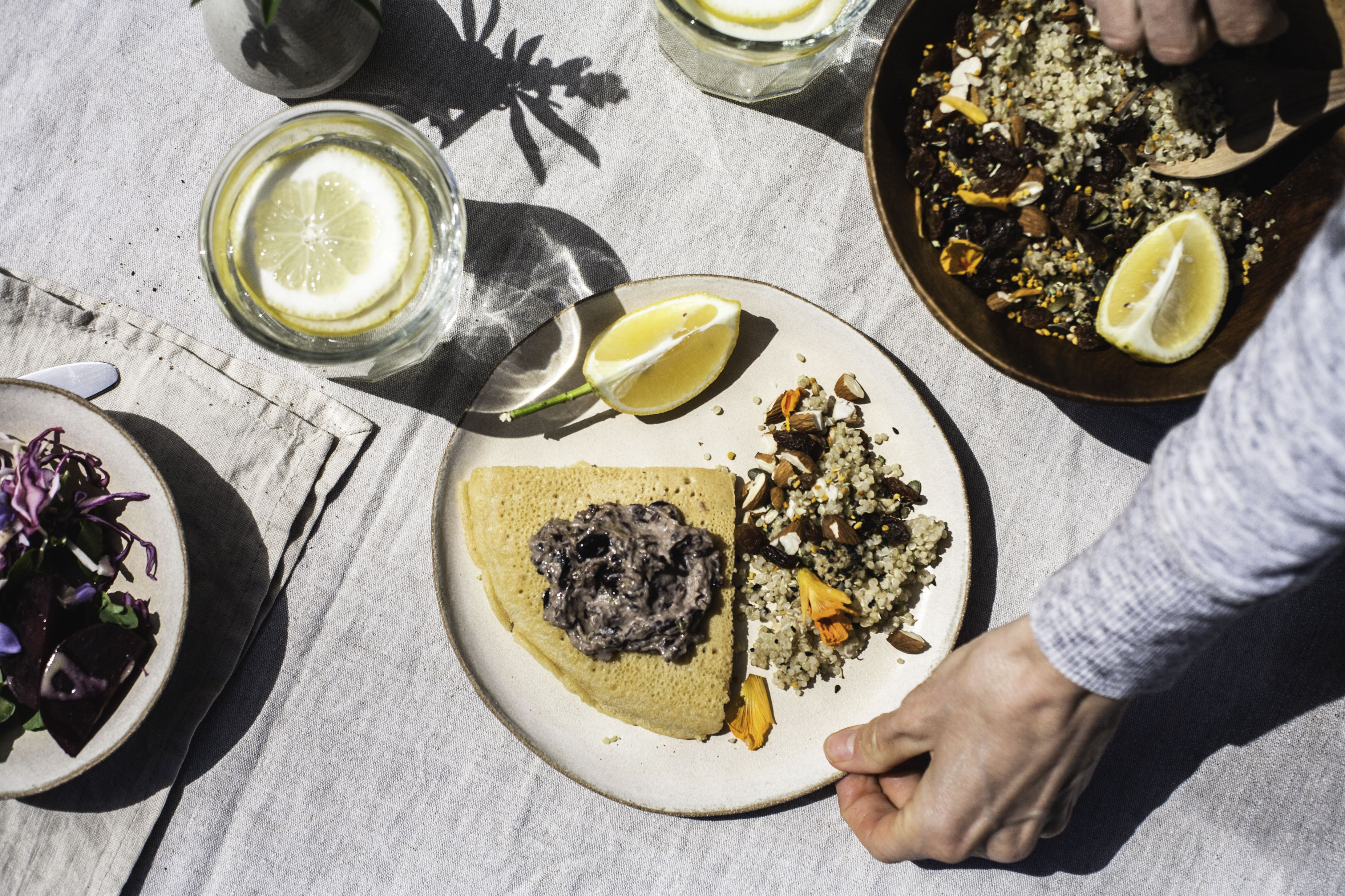 Quinoa Pilaf with Nasturtium Flowers and Socca with Blackbean hummus
