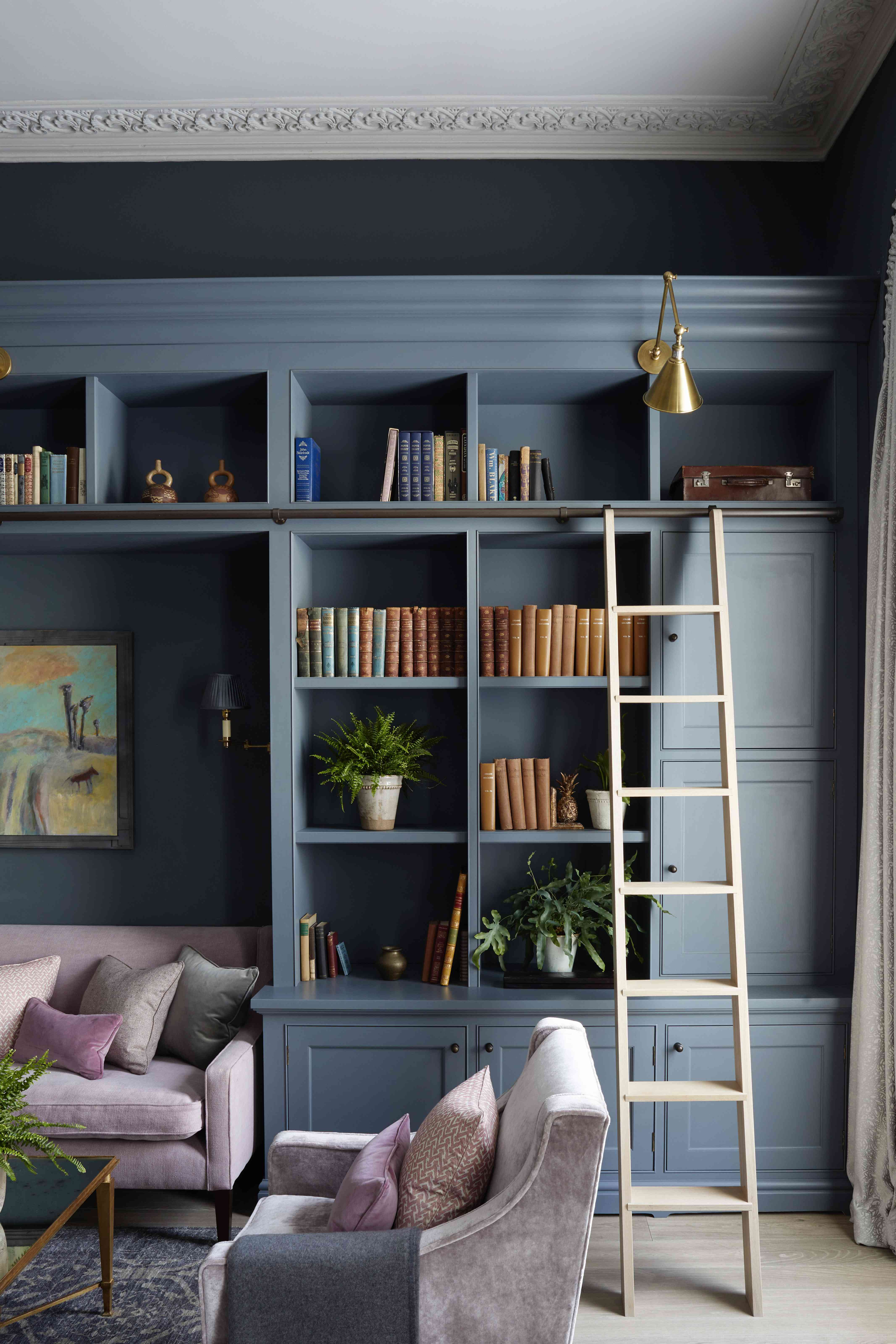 colorful book spines adorn the shelves of this built-in unit