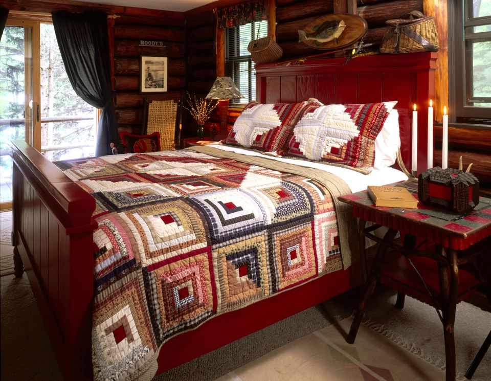 Log Cabin Quilt on Bed