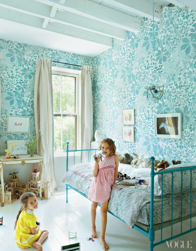 Rustic kids room with bold turquoise floral wallpaper