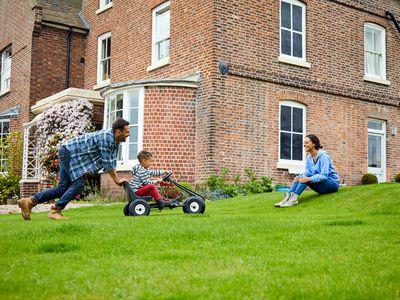 Happy family enjoying backyard