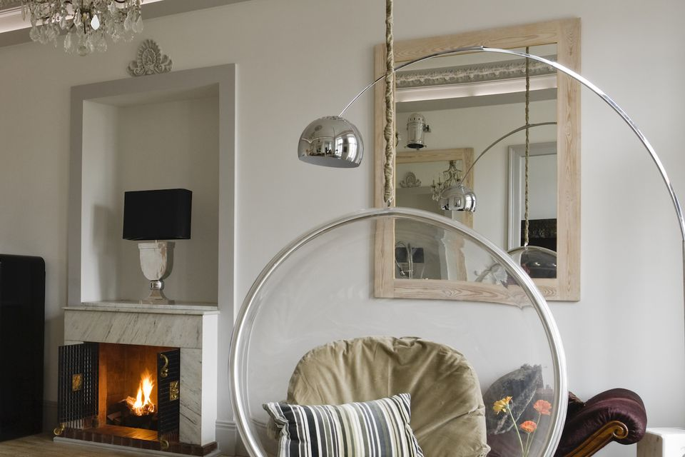 mirror hanging in a 19th century room