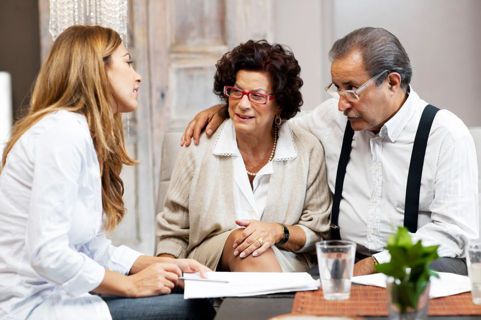 Elderly couple meeting with estate liquidator for an estate sale