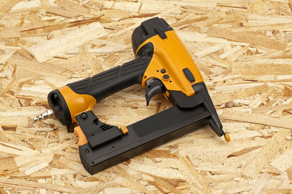 Nail Gun on a Wood Background