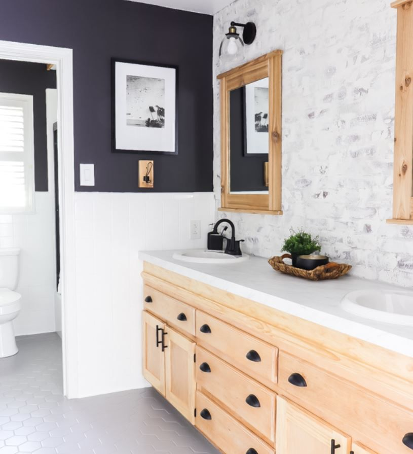 Bathroom with industrial black fixtures and raised bathroom counter.