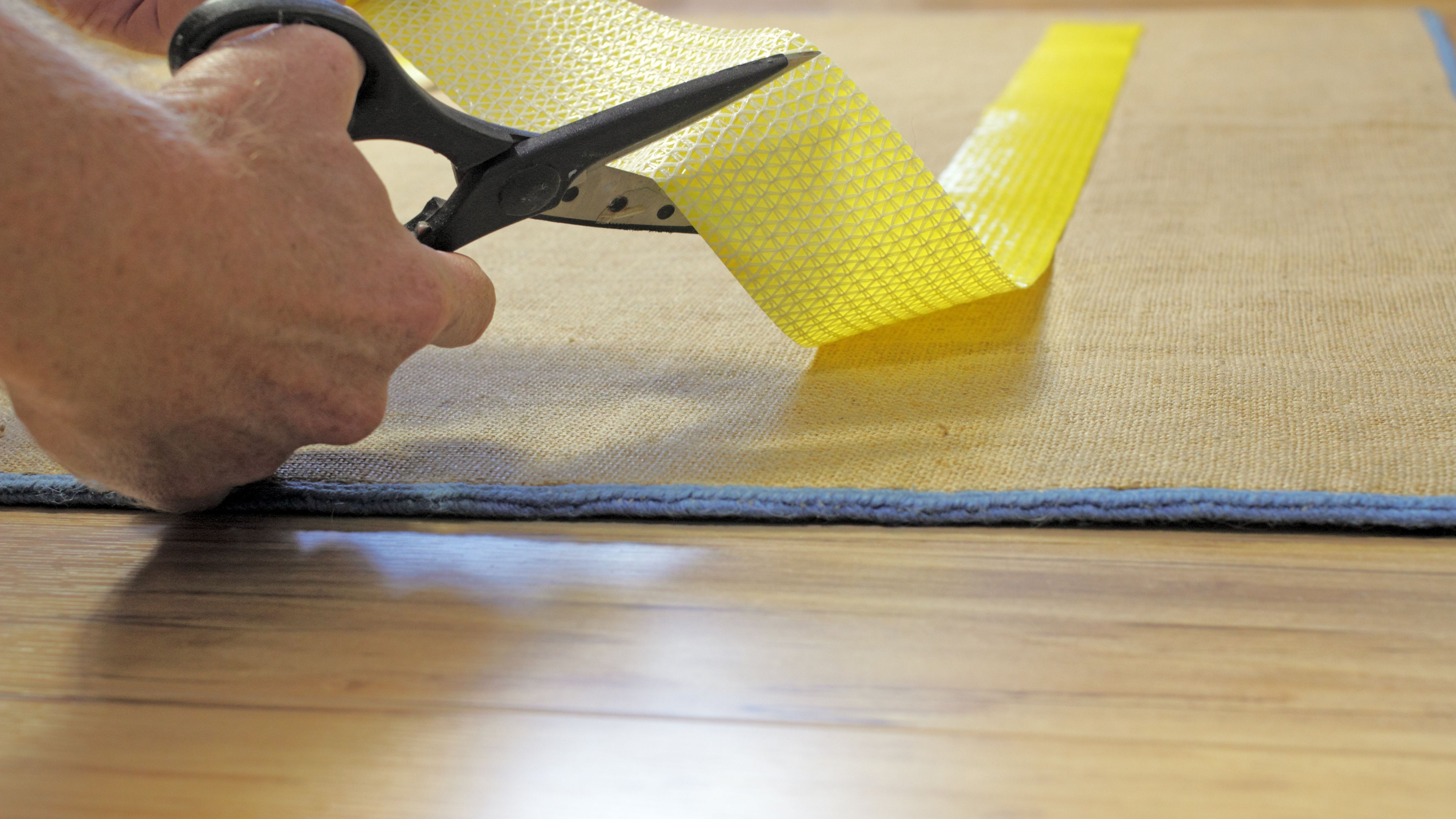 11 Tips For How To Keep Rugs From Sliding, Stop Rug From Slipping On Laminate Flooring