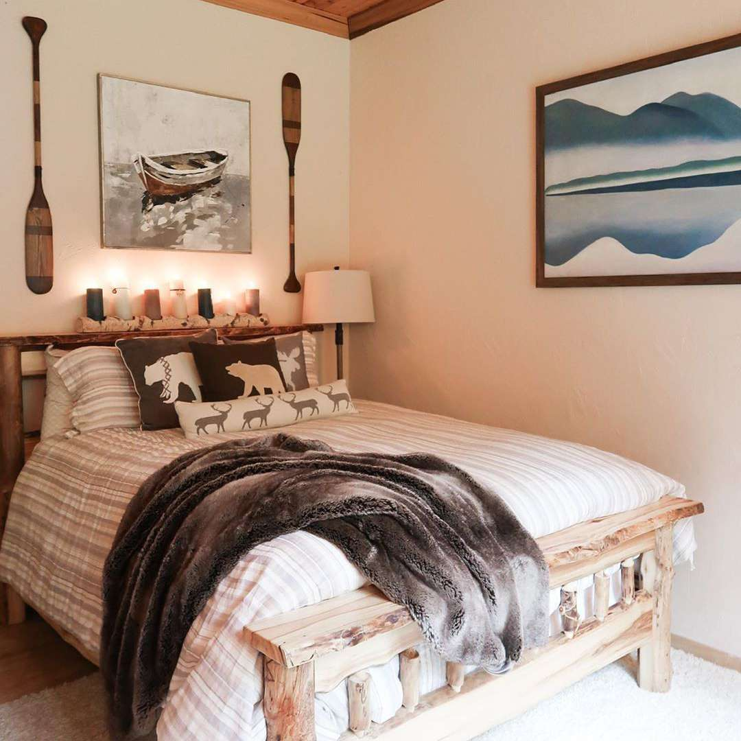 Bedroom with canoe paddles and wooden bed