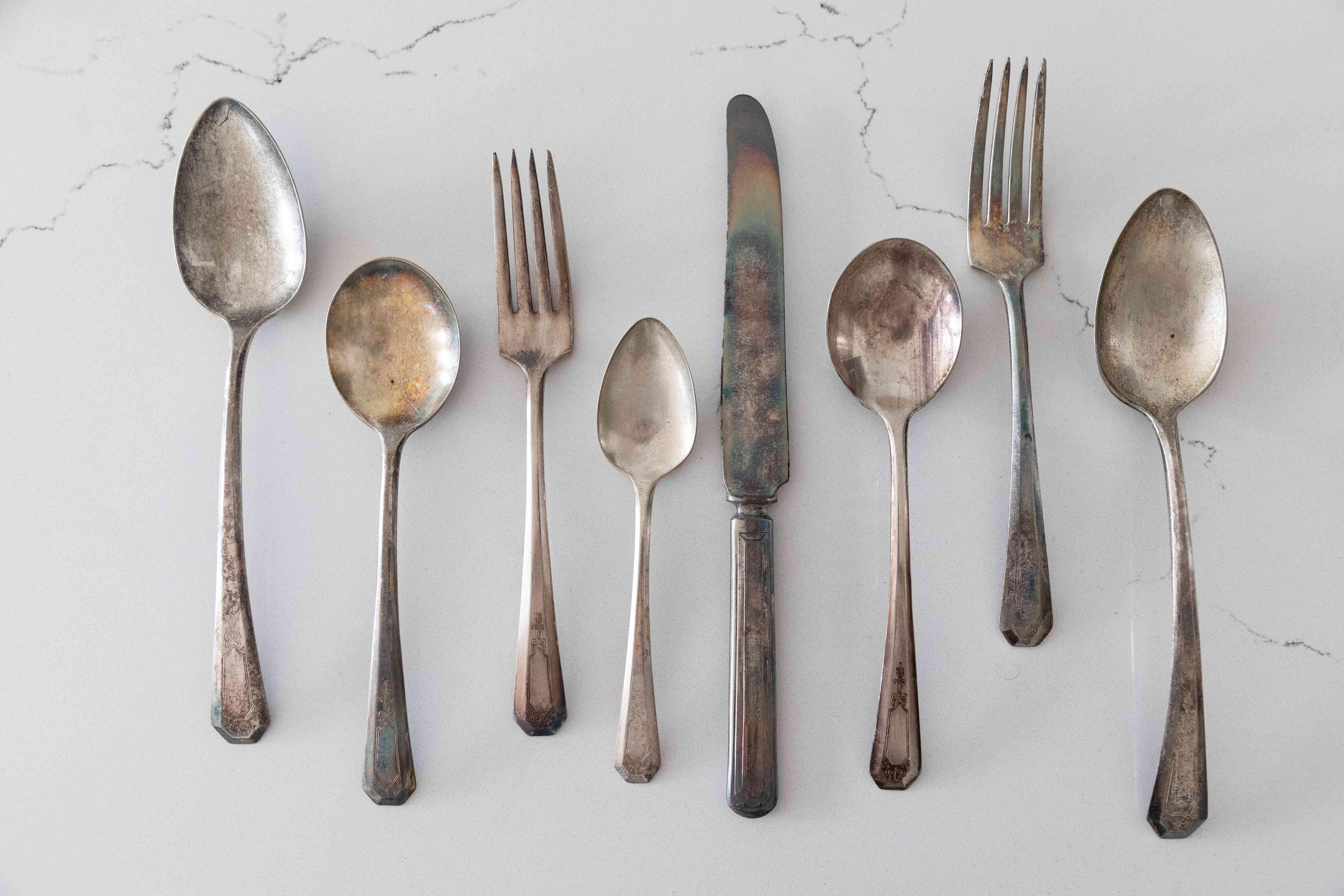 examining tarnished silver