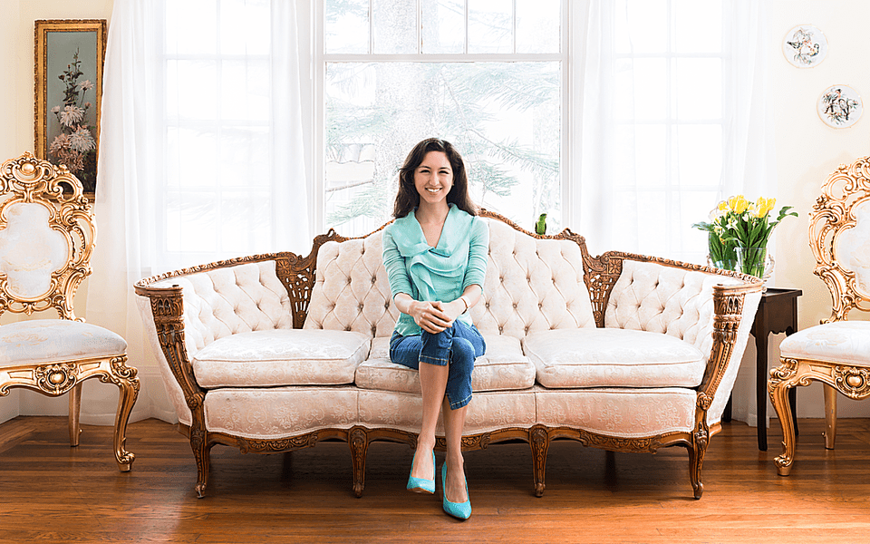 jessica greenwalt sitting on white Victorian couch