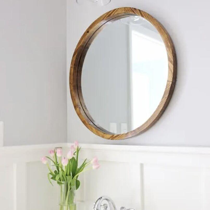 A DIY round wooden Mid-Century style mirror