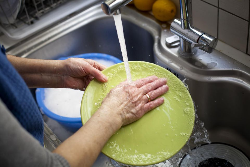 Woman washing a plate
