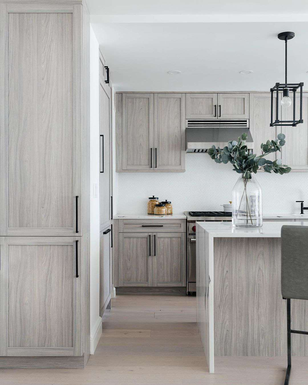 Large kitchen with gray washed cabinets