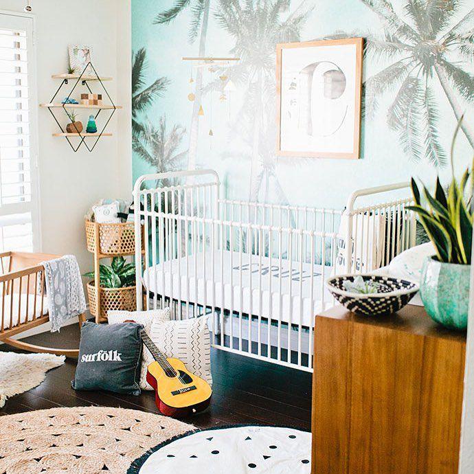 Boho-inspired beach-themed nursery with graphic palm tree mural