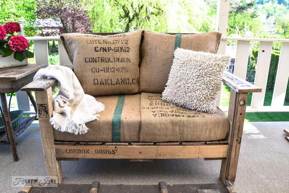A pallet love seat on a porch