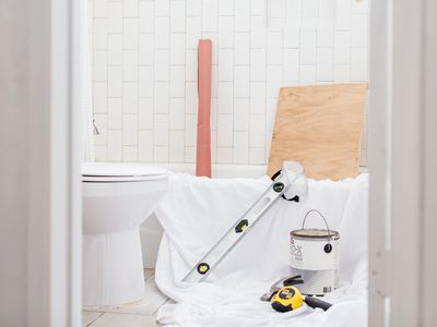 small bathroom with remodeling materials