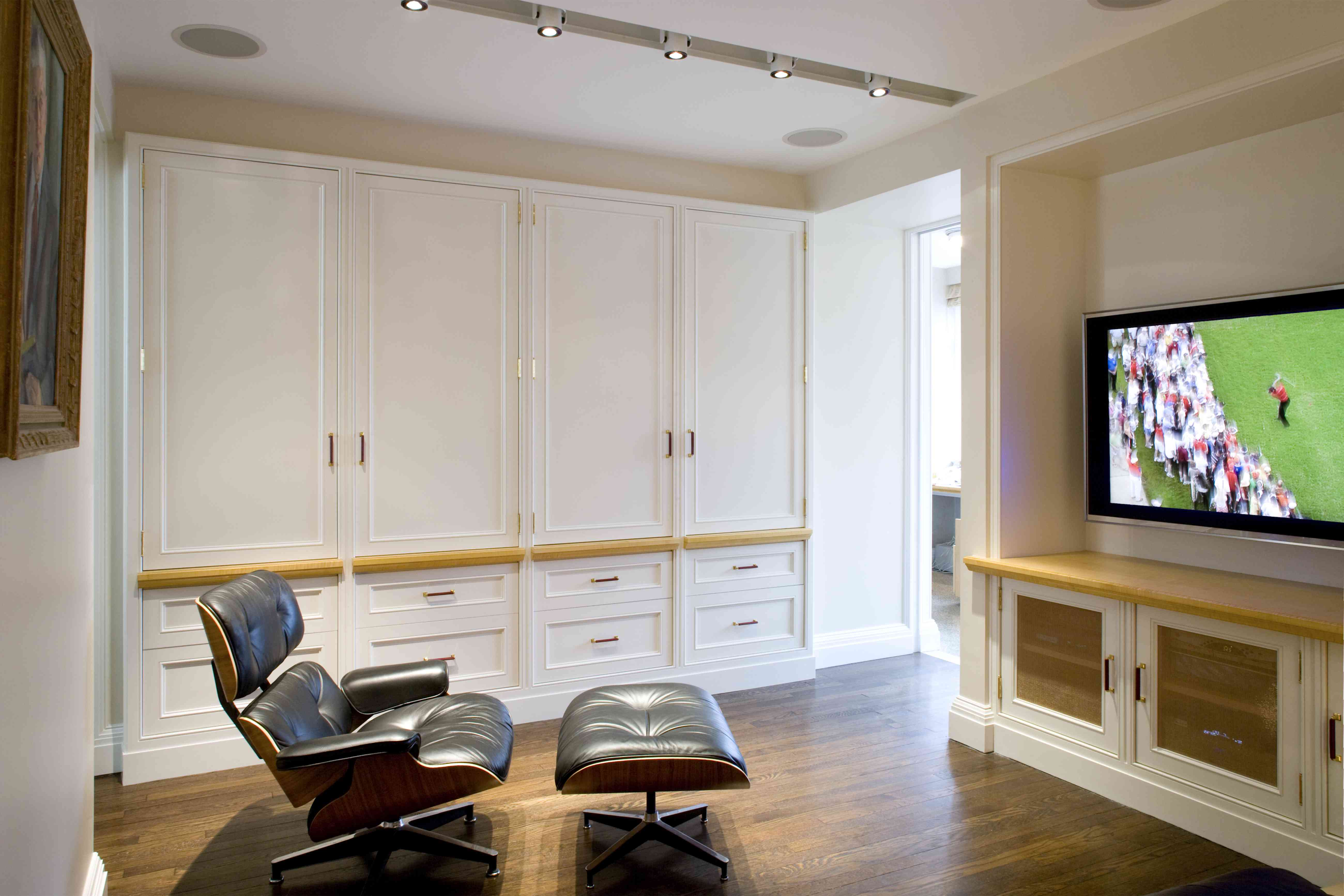 Media Room with Eames Lounge Chair and Flat screen TV