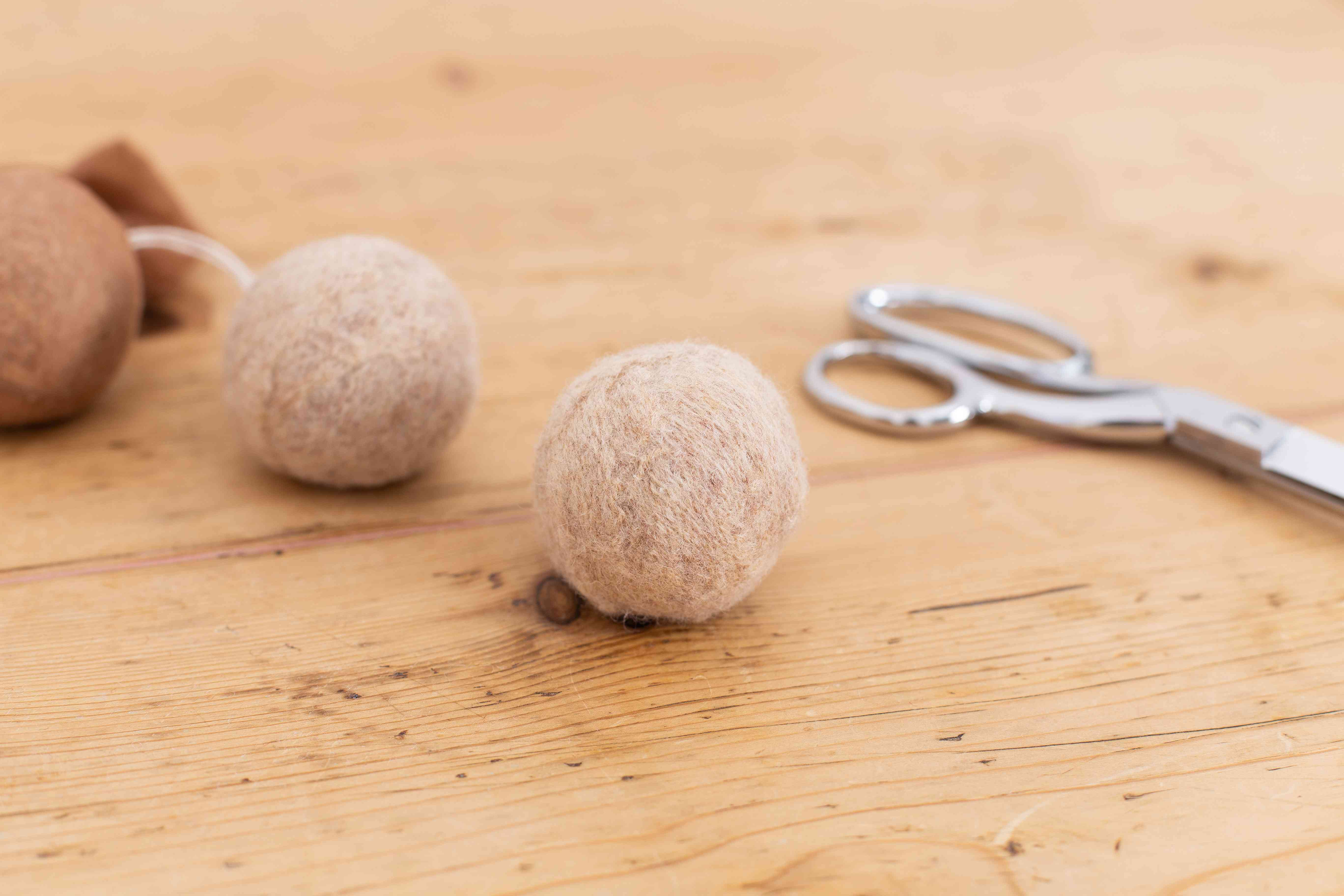Dryer balls removed from pantyhose to dry core