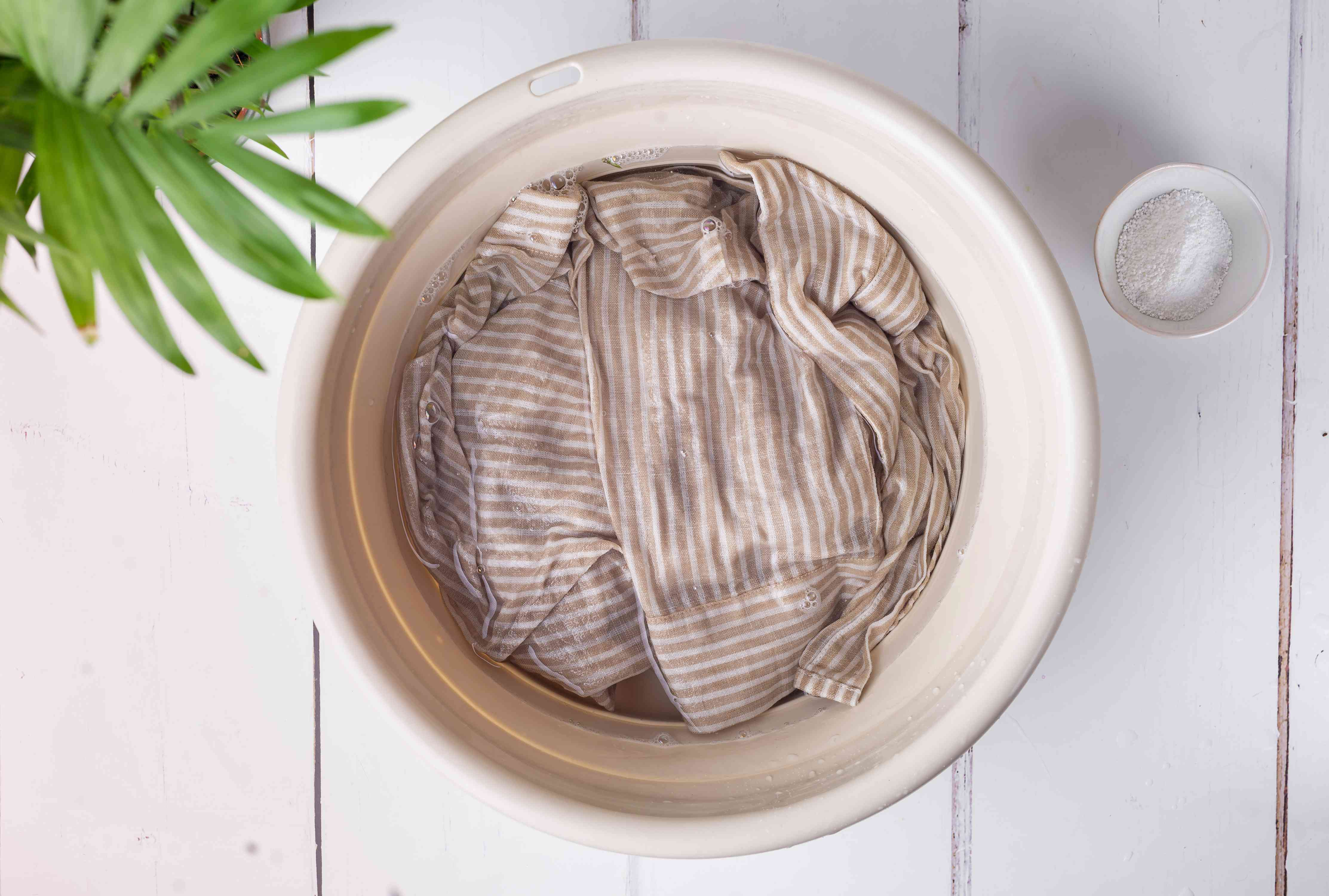 washable shirt in a basin with oxygenated bleach