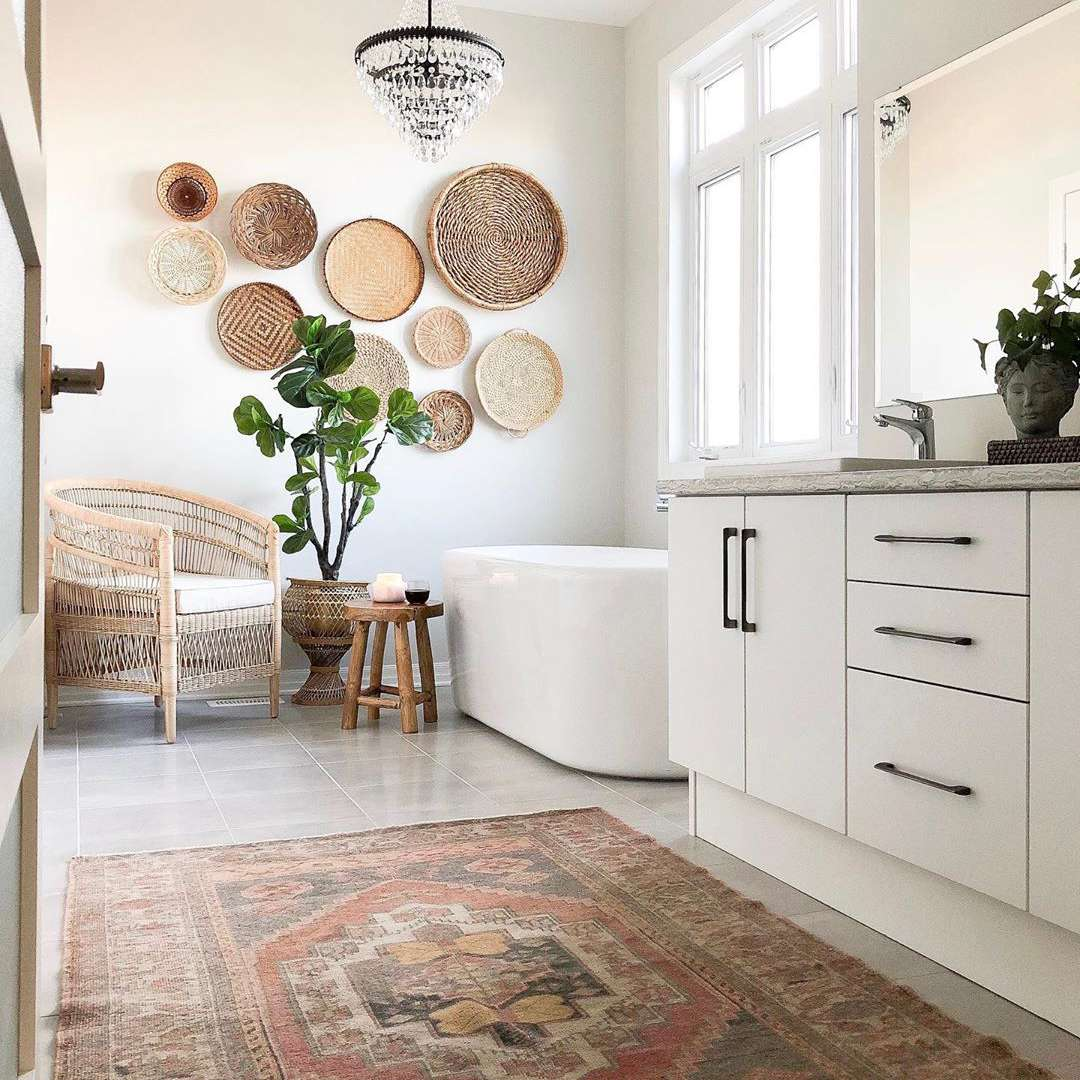 Bathroom with antique rug and basket decor