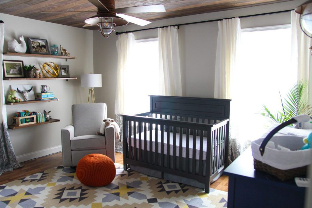 Rustic nursery with wood paneled ceiling