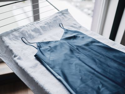 satin garment on a drying rack