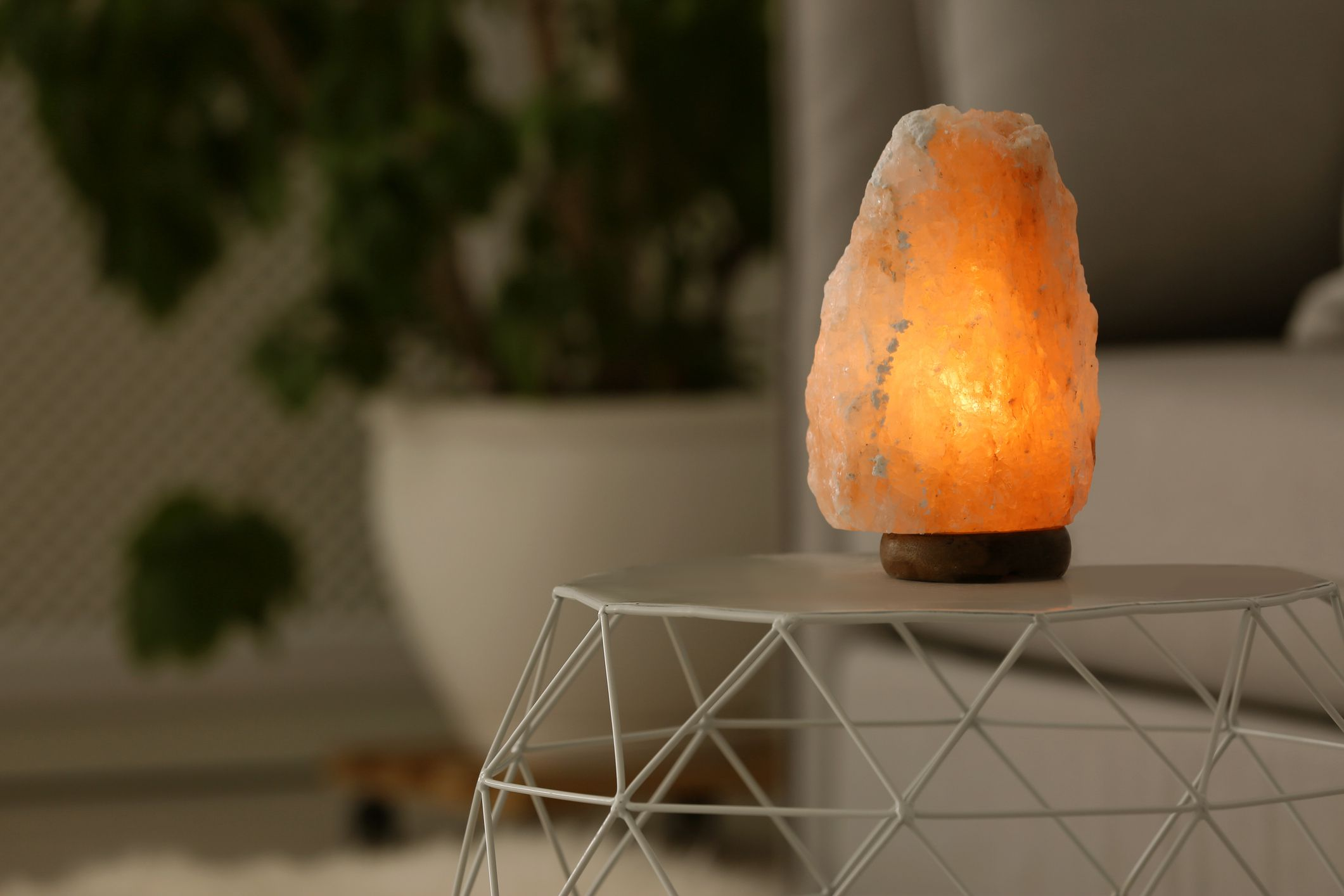 Himalayan salt lamp on a table for space clearing