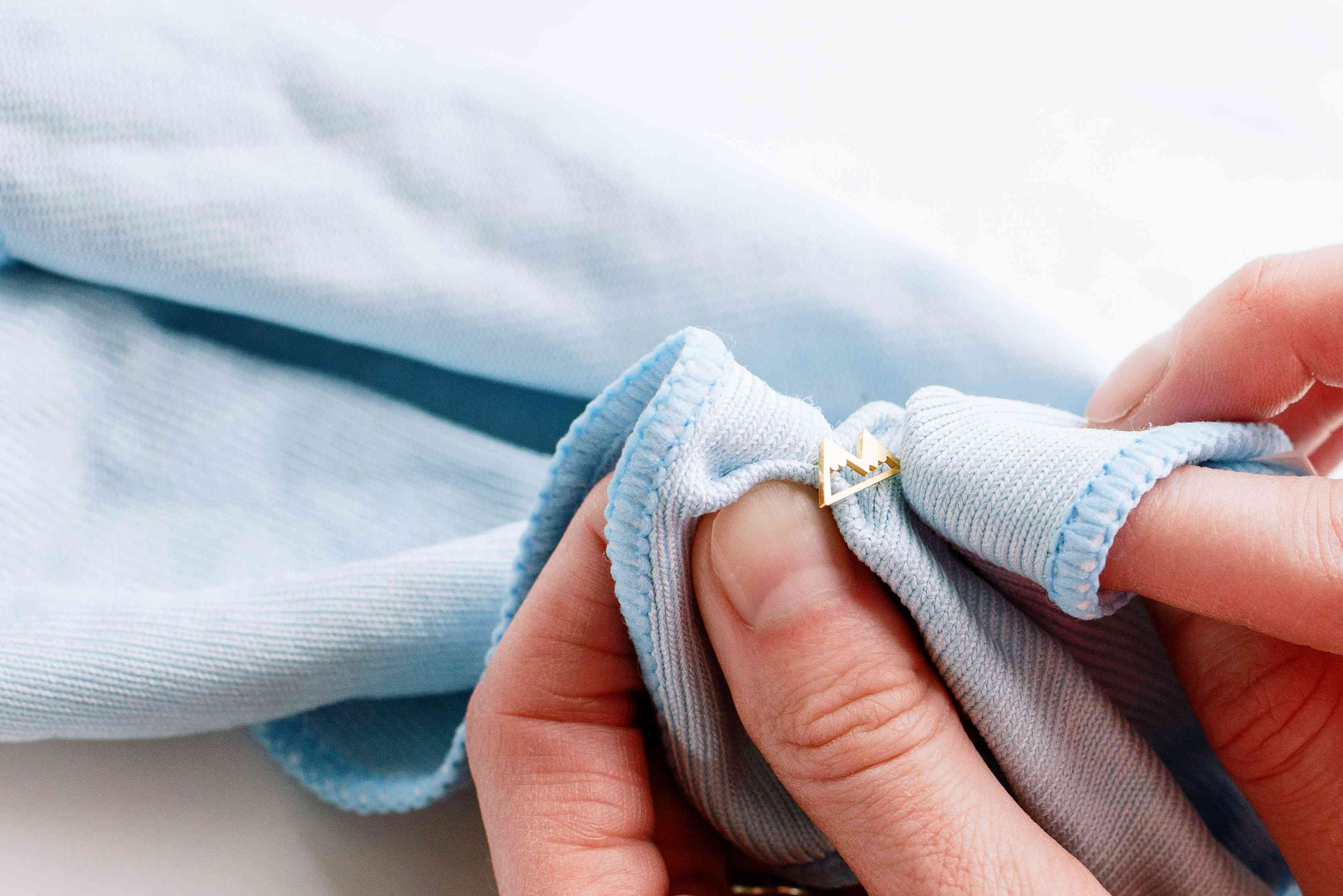 buffing jewelry with a microfiber cloth