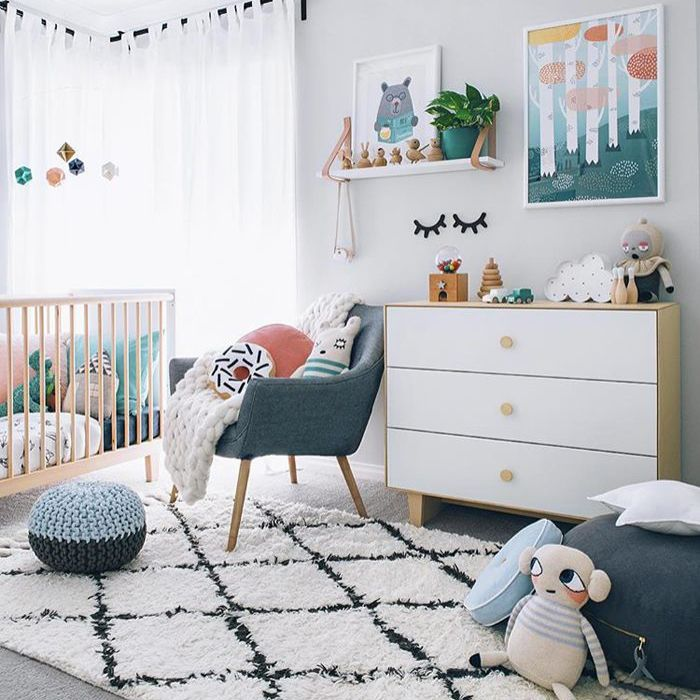 Neutral nursery room with Nordic style and lots of toys.