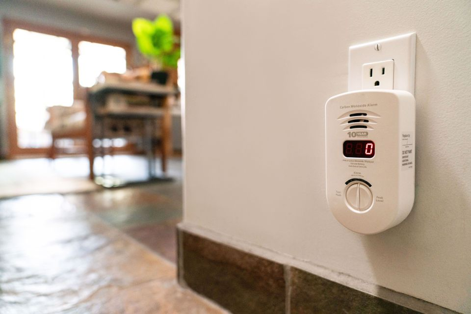 carbon monoxide detector plugged into wall