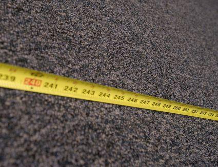 Tape measure laid across carpet