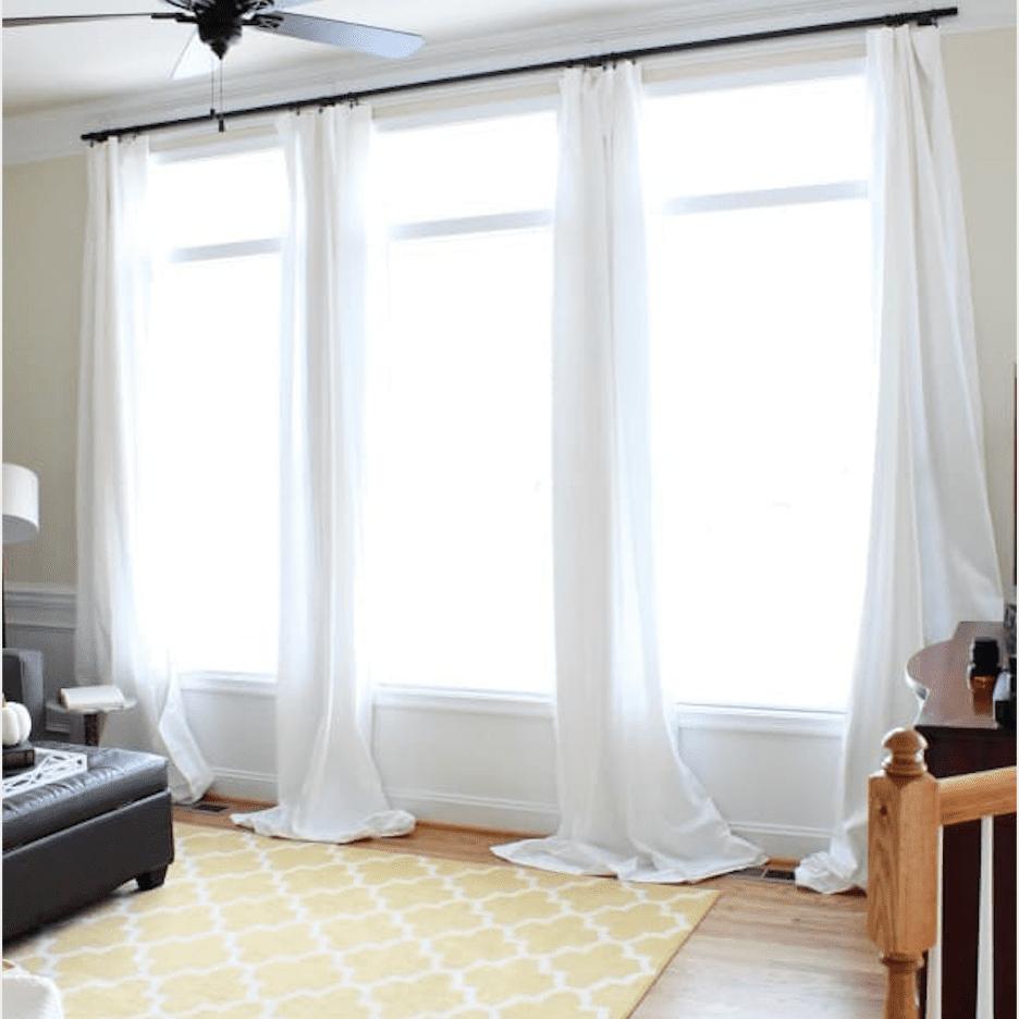 lightweight gauzy curtains hung from command hooks