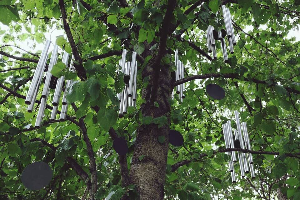 Low Angle View Of Wind Chime Hanging On Tree