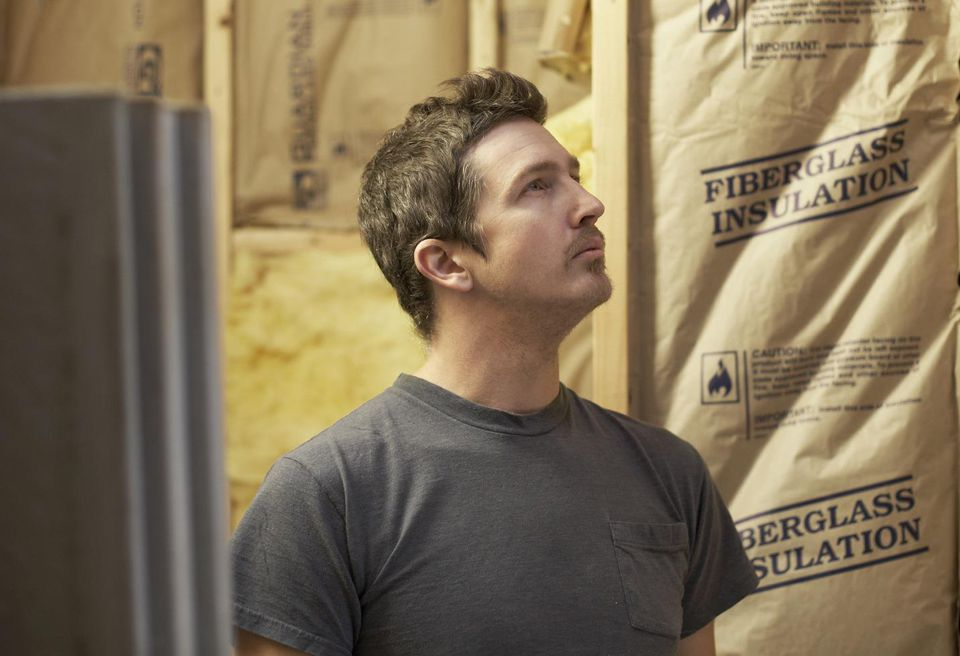 A man looking at construction insulation
