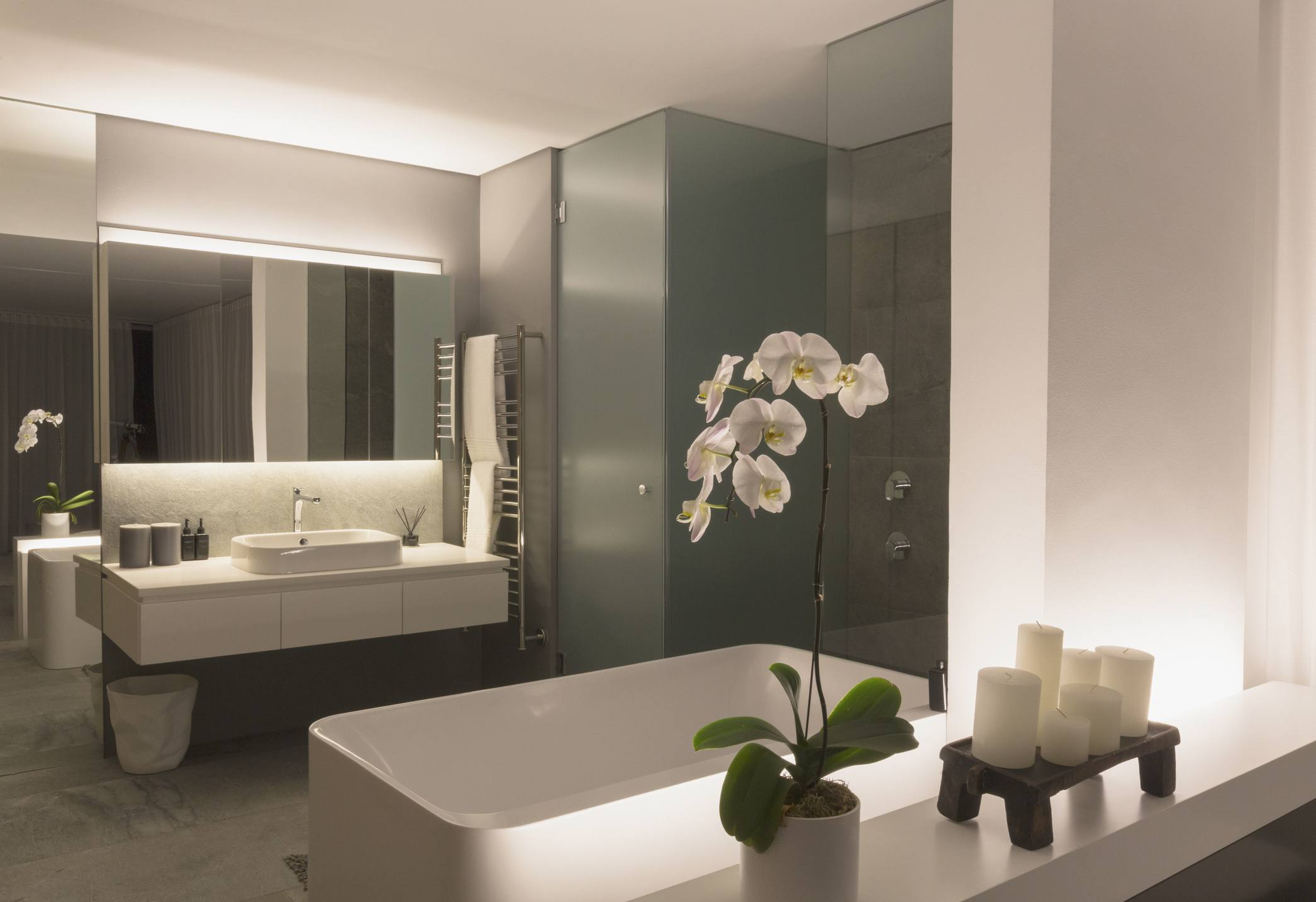 Illuminated modern, luxury home showcase bathroom