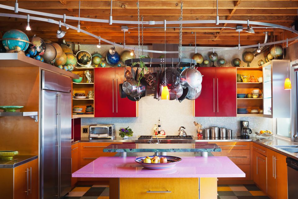 The wasted space above kitchen cabinets becomes display space for a collection of vintage globes.