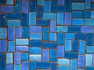 Small rectagular ceramic tiles in different tones of blue