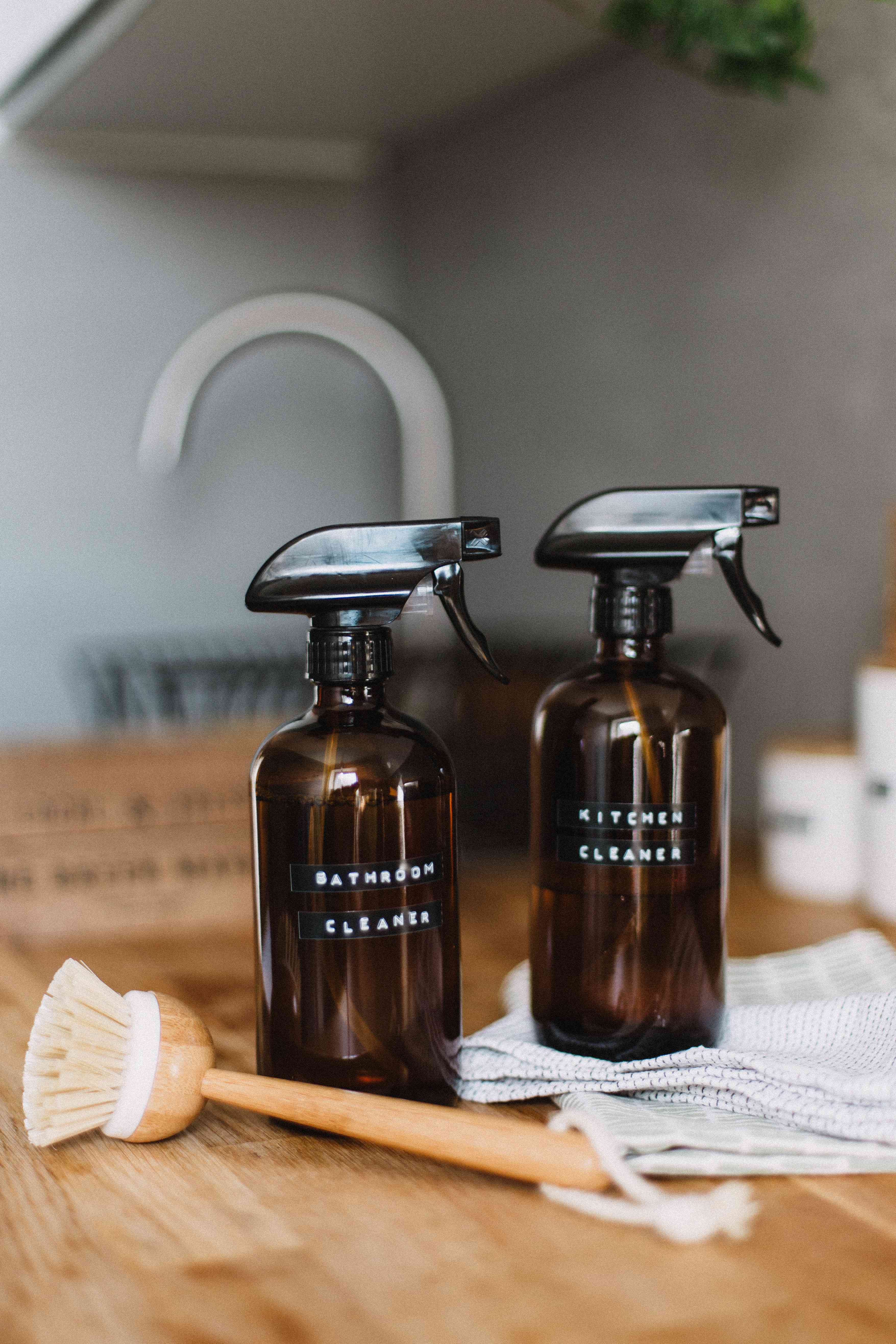 Cleaning sprays on counter in brown glass bottles