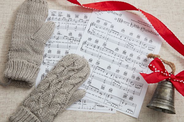 Christmas caroling music with gloves